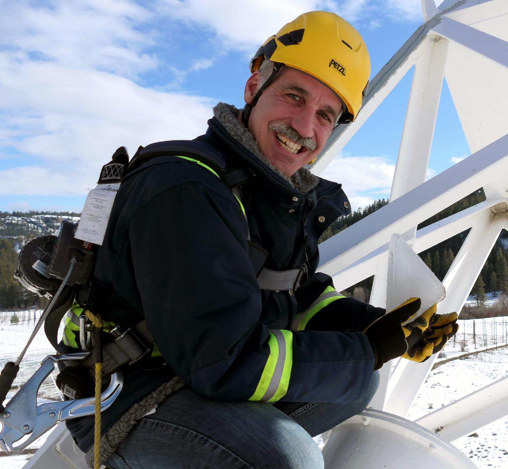 Benoit Robert, VE7EBR, working at the top of the Galt 26m dish.