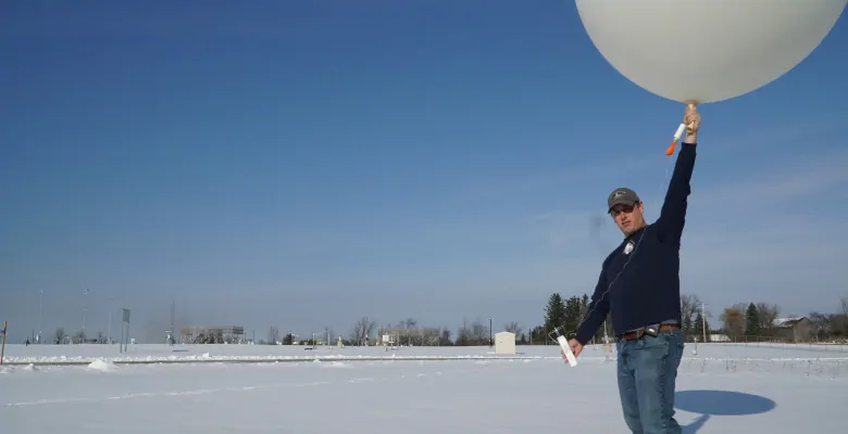 Jeff Anderson works at Environment Canada's research facility in Egbert, Ont. More than 60 weather balloons are launched each day across Canada - but their electronic packages are never recovered. (Michael Drapack /CBC )